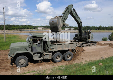 Soldiers of the Minnesota National Guard's 682nd Engineer Battalion repaired a washed-out levee that also served - Stock Photo