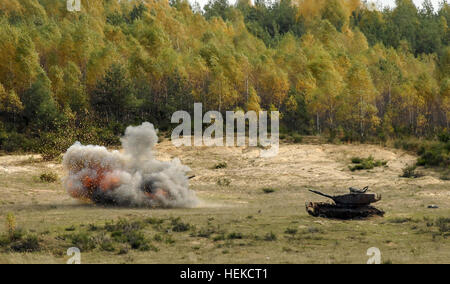 An M60 Patton tank explodes after being hit with an FGM-148 Javelin anti-tank guided missile fired by U.S. Army - Stock Photo