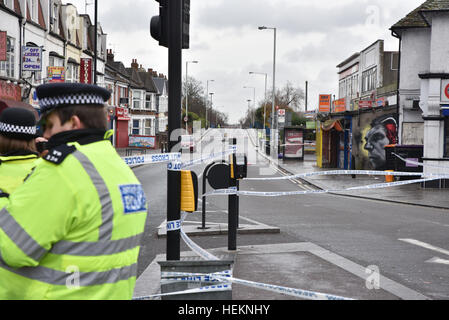 Turnpike Lane, London, UK. 23rd December 2016. Stabbing crime scene in Turnpike Lane roads cordoned off as police - Stock Photo