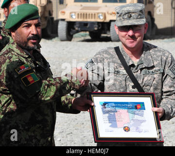 (Left to right) Afghan Brig. Gen. Zamaray Khan, the 2nd Brigade, Afghan National Army commander, presents U.S. Army - Stock Photo
