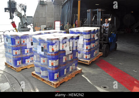 Donated goods for Project Handclasp are offloaded from High Speed Vessel (HSV 2) Swift as part of Southern Partnership - Stock Photo