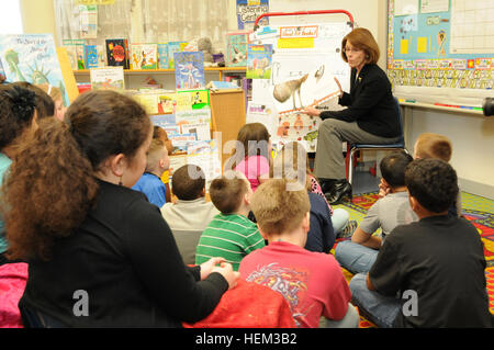 Jeanne Chandler, wife of Sgt. Maj. of the Army Raymond F. Chandler III, reads to multi-aged students at the Rose - Stock Photo