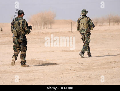 Soldiers with the Afghan National Army special forces patrol a small Afghan village during a security patrol in - Stock Photo