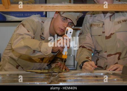 GUANTANAMO BAY, Cuba – Navy Petty Officer 3rd Class Nicholas Ullrich, a preventive medicine technician with Joint - Stock Photo