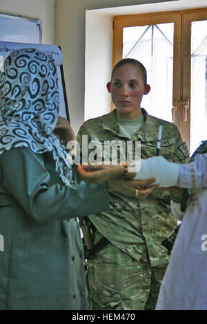 KANDAHAR, Afghanistan—Sgt. Melody Price, a medic with the Female Engagement Team for the 58th Military Police Company - Stock Photo