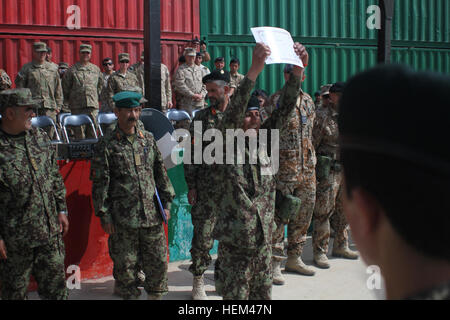an afghan national army ier holds up his diploma after   an afghan national army ier holds up his diploma after graduating from a course at the