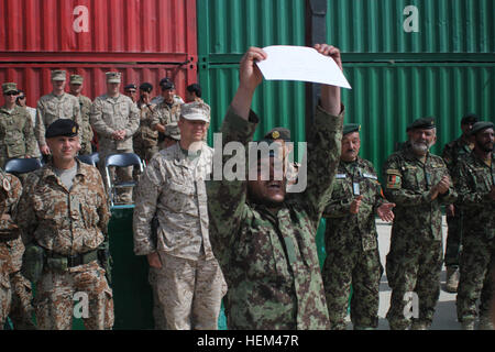 an afghan national army ier holds up his diploma after  troops in · an afghan national army ier holds up his diploma after graduating from a course at the