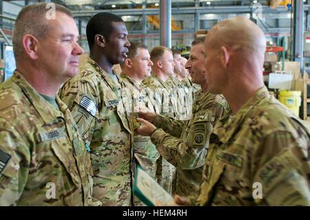 Col. T.J. Jamison, 82nd Combat Aviation Brigade commander, of Broken Arrow, Okla., awards Chief Warrant Officer - Stock Photo