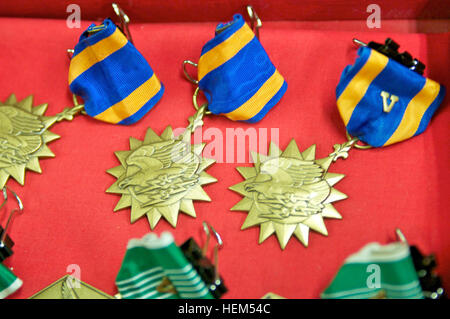 The Air Medal is a U.S. military decoration awarded for meritorious achievement while participating in aerial flight. - Stock Photo