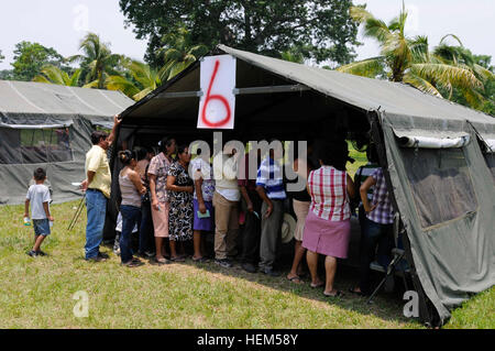 Citizens in the area of San Marcos line up at the ophthalmology tent to receive free vision care. The medical readiness - Stock Photo