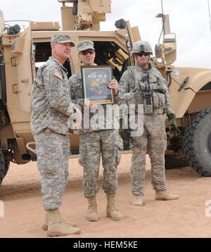 U.S. Army Brig. Gen. Randal Dragon, Brigade Modernization Command commander, gives Col. Richard D. Clarke, deputy - Stock Photo