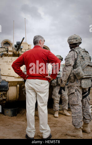 Secretary John McHugh, the 21st secretary of the Army, stands next to a Bradley Tank, while talking with a 2nd Heavy - Stock Photo