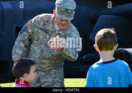 THERESA, NY – Capt. Shawn Bowden, a pilot assigned to F Company, 1st Battalion, 10th Combat Aviation Brigade, talks - Stock Photo