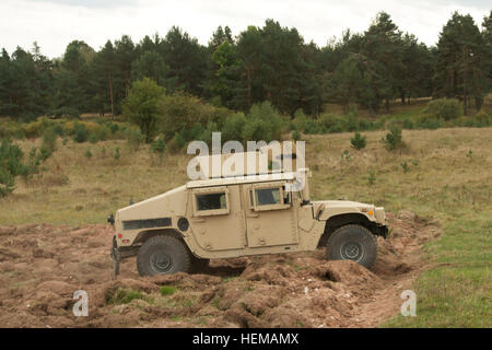 Soldiers of the 615th MP Company enter an obstacle path driving a on the new Driver's Training complex at the Grafenwoehr - Stock Photo