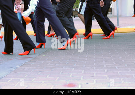 Men in red high-heel shoes march along the streets of El Paso, Oct. 16, 2012, to support  the Young Women's Christian - Stock Photo