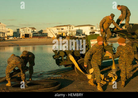 Marines with 8th Engineer Support Battalion prepare to pump storm water from homes during Hurricane Sandy recovery - Stock Photo