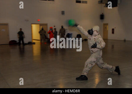 A member from the 91st Civil Support Team of the Arizona National Guard, counters a shot, smacking the ball back - Stock Photo