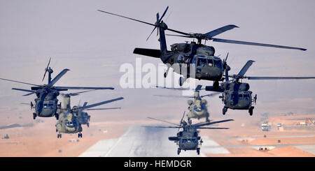 Six UH-60L Black Hawks and two CH-47F Chinooks, assigned to Task Force Brawler, 4th Battalion, 3rd Aviation Regiment, - Stock Photo