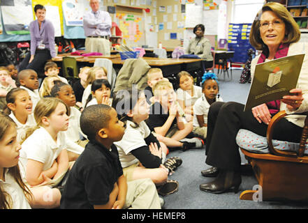 Jeanne Chandler, the wife of Sgt. Maj. of the Army Raymond Chandler, reads a book to second-graders in Jennifer - Stock Photo
