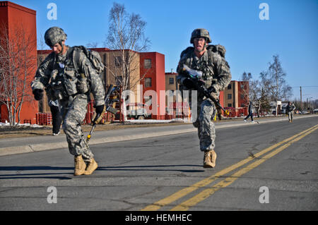 U.S. Soldiers with the 4th Brigade Combat Team, 25th Infantry Division, race to complete the 12-mile foot march - Stock Photo