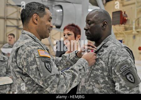Maj. Gen. Michael X. Garrett, commander United States Army Alaska, presents Command Sgt. Maj. Terry Gardner the - Stock Photo