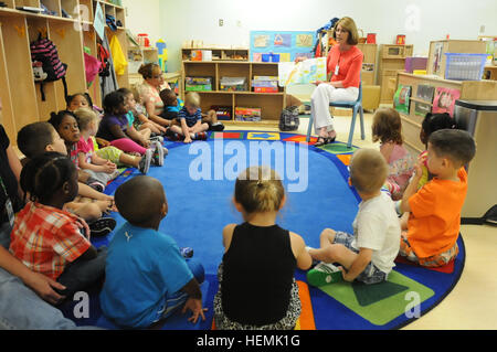 Jeanne Chandler, wife of Sgt. Maj. of the Army Raymond F. Chandler III, reads one of her favorite children's books - Stock Photo