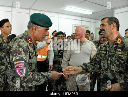 Afghan National Army Maj. Gen. Sayed Malook, (far right) commander of the 215th Corps, hands over a key to the newly - Stock Photo