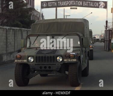 A convoy of High Mobility Multi-Wheeled Vehicles (HMMWV) depart Pier 8 on the Port of Pusan, Republic of Korea, - Stock Photo