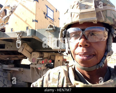 Staff Sgt. Sheila D. Lucious, a native of Chicago, 3rd squad team leader, truck commander, 1230th Transportation - Stock Photo