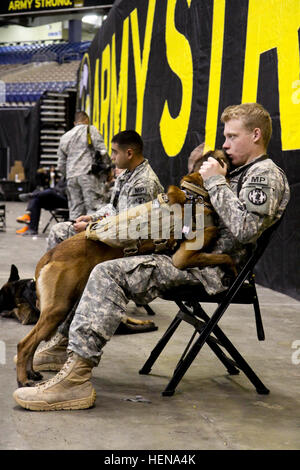 A military police officer and his canine partner take a moment to share mutual affection during the 2014 U.S. Army - Stock Photo