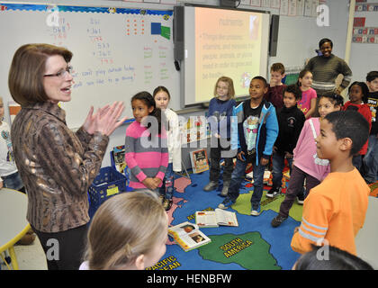 """Jeanne Chandler, wife of Sgt. Maj. of the Army Raymond F. Chandler III, teaches a little ditty she calls, """"The Army - Stock Photo"""