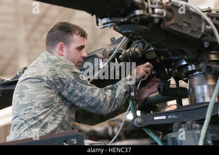 U.S. Air Force Tech. Sgt. Lee McWhorther, of the 2nd Airlift Squadron, 43rd Airlift Wing, attaches cables in the - Stock Photo