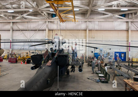 The 82nd Combat Aviation Brigade soldiers use the hoist in their hangar to suspend the cables of the Unit Maintenance - Stock Photo