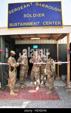 Air Force Brig. Gen. Michael Fantini, commander of Kandahar Airfield cuts the ceremonial ribbon at the grand opening - Stock Photo