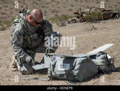 FORT IRWIN, Calif. - A U.S. Army Soldier, assigned to 977th Military Police Company, 97th Military Police Battalion, - Stock Photo