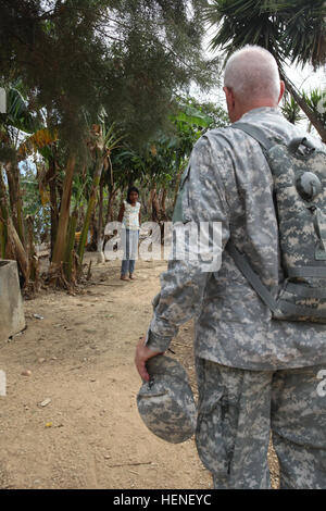 Master Sgt. John Barneson, assigned to the 318th PsyOp Company, speaks with a Guatemalan child, discussing about - Stock Photo