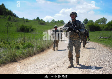 U.S. Army Staff Sgt. Nathan A. Harrison along with paratroopers assigned to Battle Company, 2nd Battalion, 503rd - Stock Photo
