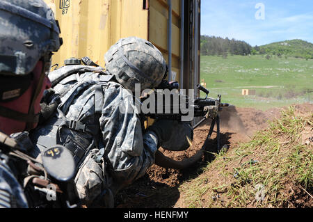 U.S. paratroopers assigned to Battle Company, 2nd Battalion, 503rd Infantry Regiment, 173rd Infantry Brigade Combat - Stock Photo