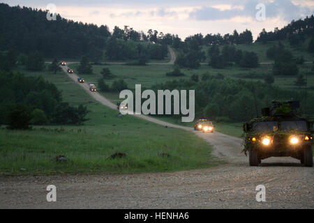 U.S. Soldiers from the 1st Brigade, 1st Cavalry Division and the 16th Sustainment Brigade conduct a tactical convoy - Stock Photo