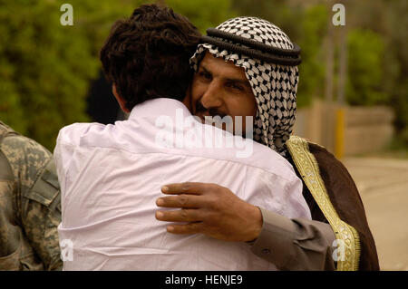 A district leader of Jamiya, Baghdad, Iraq, welcomes an Iraqi detainee who was released as part of  Operation Lion's - Stock Photo
