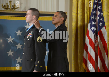 President Barack Obama, right, awards former Army Staff Sgt. Ryan Pitts the Medal of Honor during a ceremony in - Stock Photo