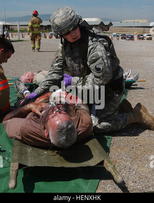 Sgt. Carolyn Gallagher, a reservist attached to the 29th infantry Division, yells for help during a mass casualty - Stock Photo