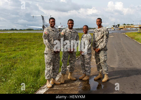 From left, a team of four Soldiers, Sgt. Lia Green, Cpl. Kenardo Bates, Spc. Clinton Bowles and Spc. Tessica Charles, - Stock Photo