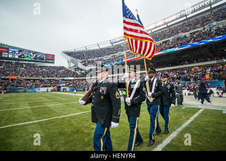 A color guard team from the Chicago Recruiting Battalion carries the American and Army flags onto the field prior - Stock Photo