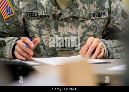 First Sgt. Raquel Steckman works on an operations order for an upcoming demolition range for the Army Reserve 374th - Stock Photo