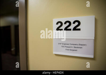 A placard hangs outside of the office of 1st. Sgt. Raquel Steckman, the first woman in the Army appointed to a combat - Stock Photo