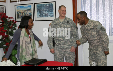 Retired U.S. Army 1st  Sgt. Myra Austin, a native of Mobile, Ala., laughs with Soldiers after her speech at the - Stock Photo