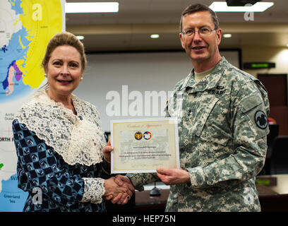 Kate Campbell Stevenson, left, is presented a certificate of appreciation from Maj. Gen. David Conboy, U.S. Army - Stock Photo