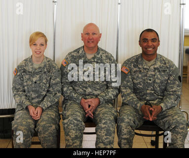 Capt. Philip J. Walters, Spc. Armand H. Jackson and Spc. Heather L. Sinclair, from the 328th Brigade Support Battalion, - Stock Photo