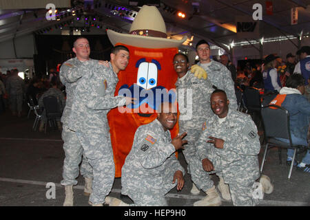 Soldiers from Fort Hood, Texas, pose for a picture with the mascot of the Houston Livestock show and Rodeo, March - Stock Photo